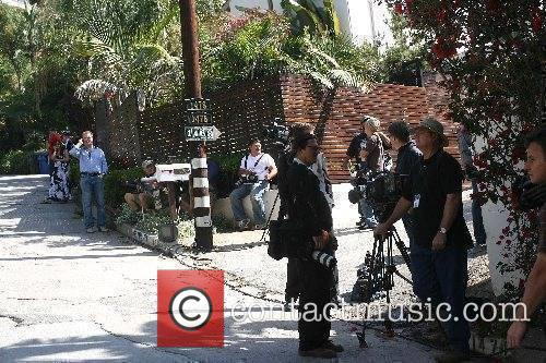 Media gather near the Los Angeles home of...