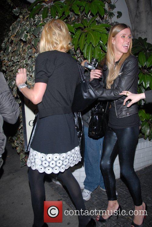 Paris Hilton and Nicky Hilton looking very happy...