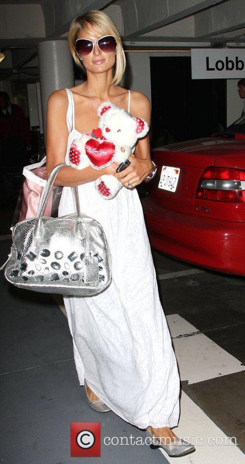 Paris Hilton carrying a stuffed teddy bear Los...