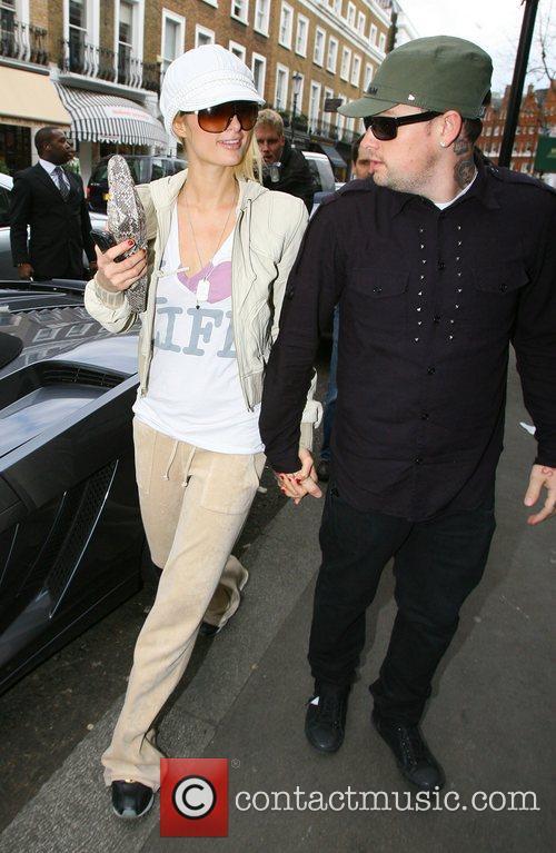 Paris Hilton and Benji Madden arriving at a...