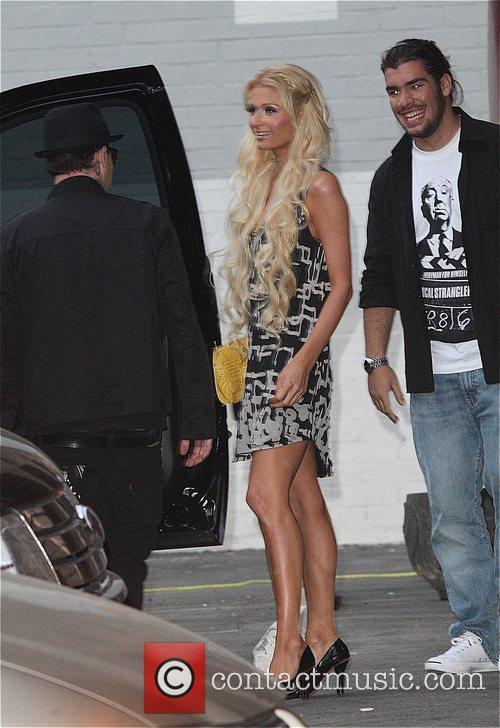 Benji Madden and Paris Hilton outside a studio...