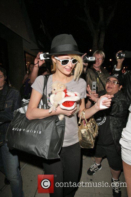 Paris Hilton and Alex Vaggo leaving Alice +...