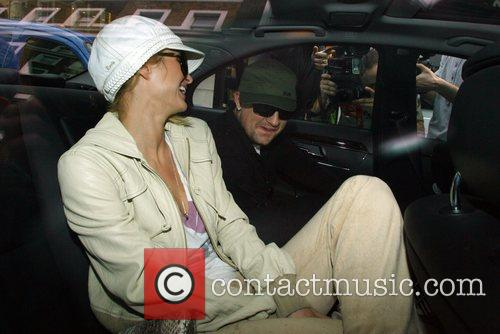 Paris Hilton and Benji Madden leaving a restaurant...