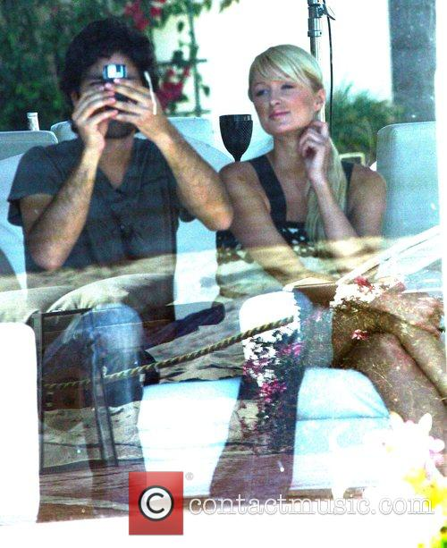 Paris Hilton with Adrian Grenier recording her new...