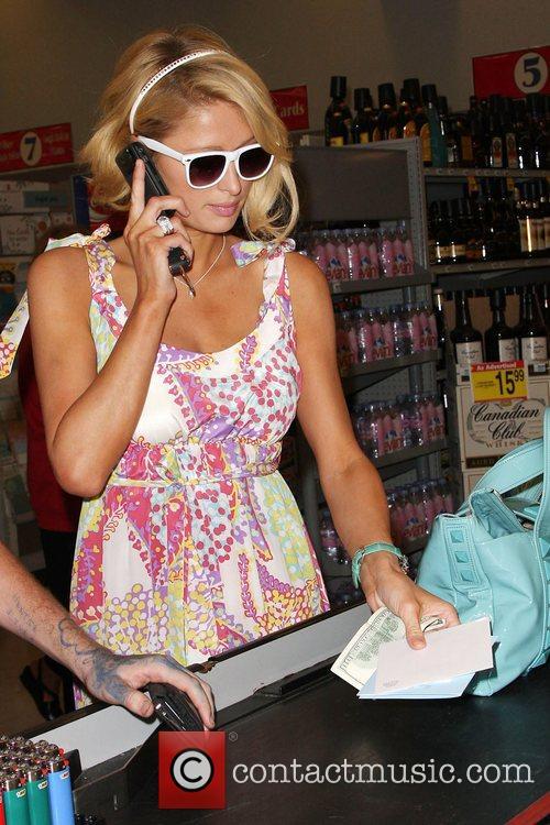 Paris Hilton picks up a birthday card for...