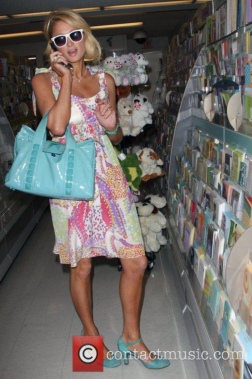 Paris Hilton picks up a birthday card for...