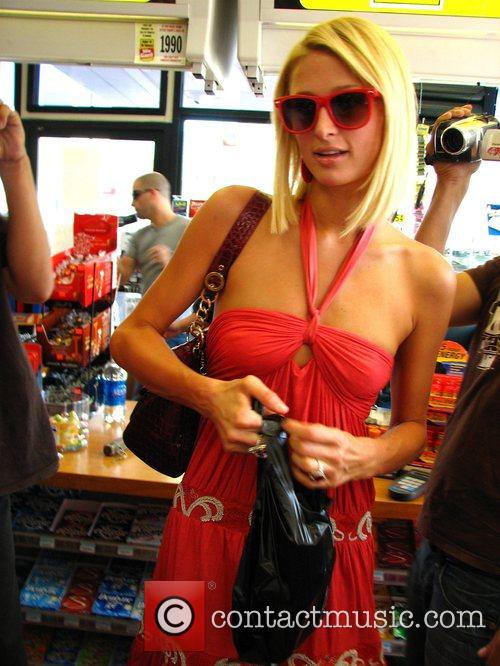 Paris Hilton stops at a gas station along...
