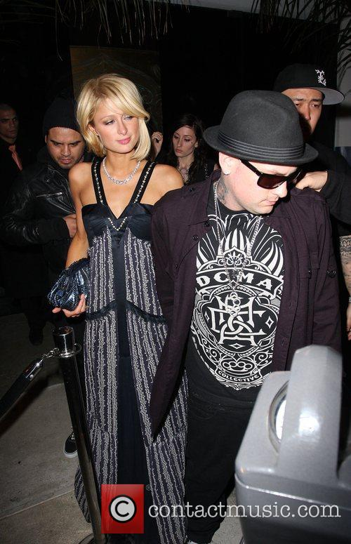 Paris Hilton and Benji Madden arriving at and...