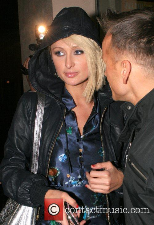 Paris Hilton at a gas station with her...