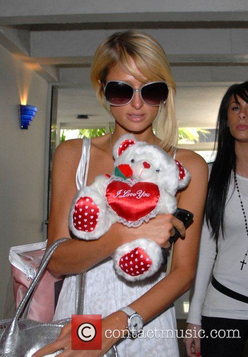 Paris Hilton arrives at Orchid hair salon carrying...