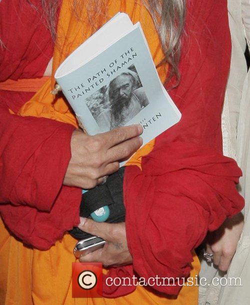 Paris Hilton arriving at the Bodhi Tree bookstore...