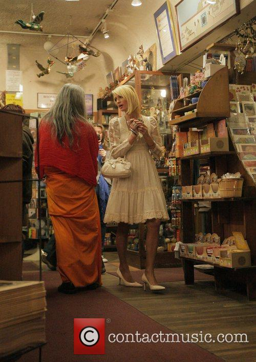 Paris Hilton shopping at the Bodhi Tree bookstore...