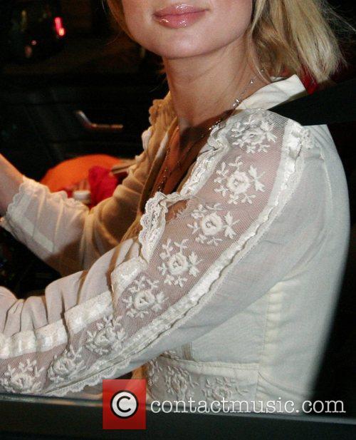 Paris Hilton reveaing a rip in her dress...