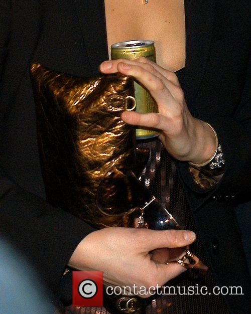 Paris Hilton with a can of Rich prosecco...