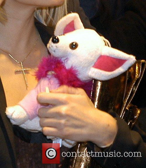Paris Hilton with a cuddly toy leaving Hilton...