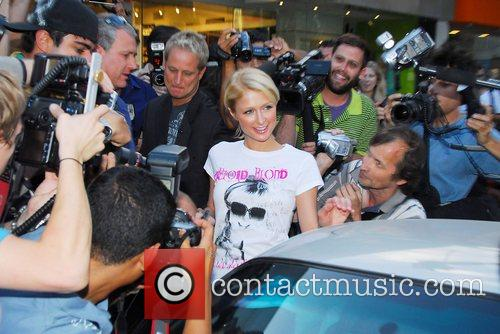 Paris Hilton, Ken Olandt Aka Cyber Guy Go To Kitson Boutique On Robertson Boulevard To Promote An Auction and Offering Fans The Chance To Go On A Shopping Spree With Her. 3