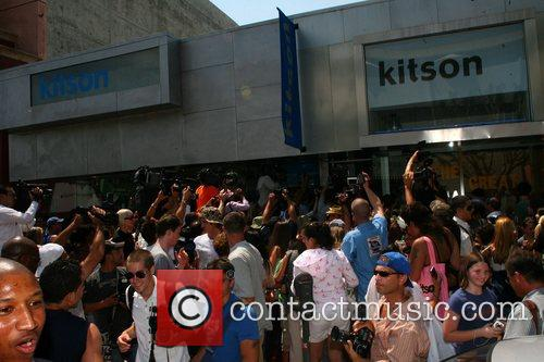 Crowds gather outside Paris Hilton promoting her new...
