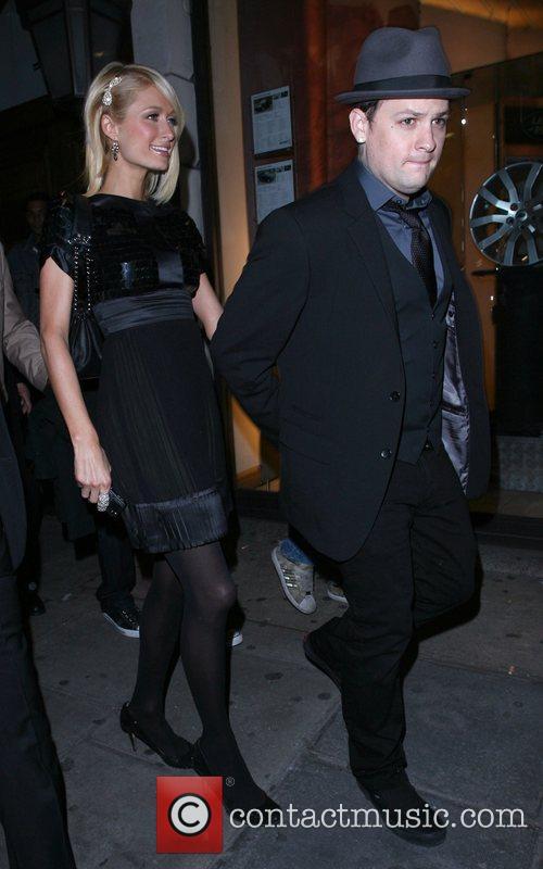 Paris Hilton and her boyfriend Benji Madden leaving...