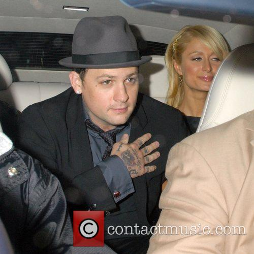 Paris Hilton and her boyfriend Benji Madden leaving...