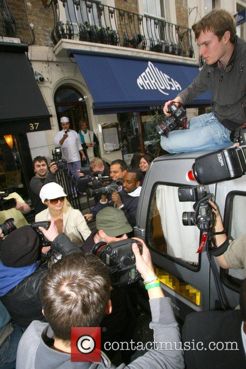 Paris Hilton and Benji Madden mobbed by fans...