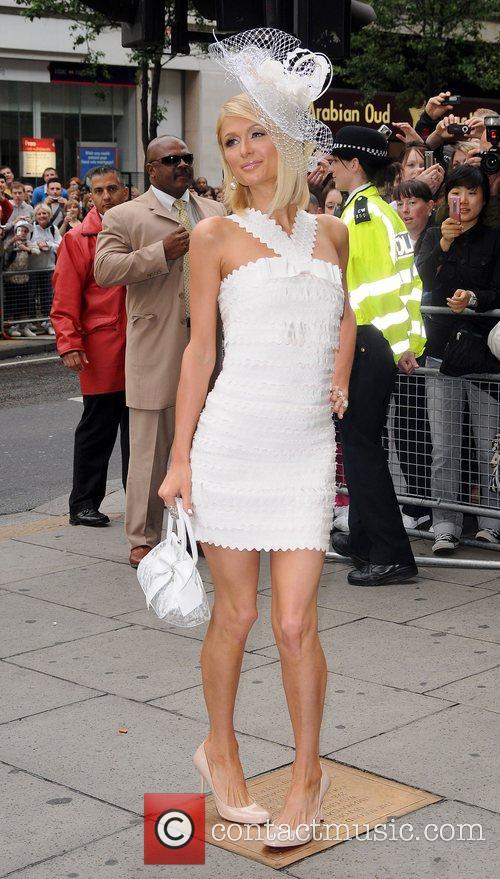Paris Hilton arrives at Selfridges, Oxford Street for...