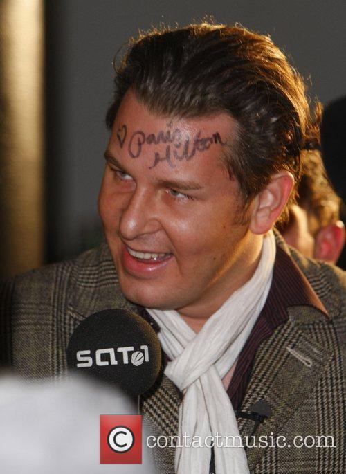 SAT.1 TV reporter Christian Dittborn with a Paris...