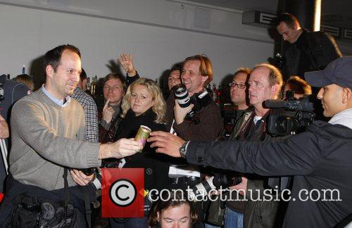 Rich Prosecco is handed out to photographers at...