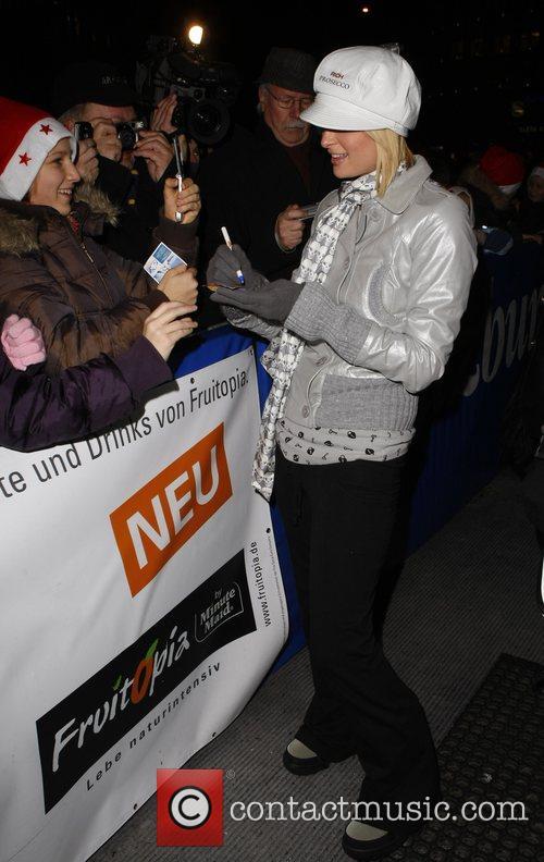 Paris Hilton signing autographs at the artificial ski...