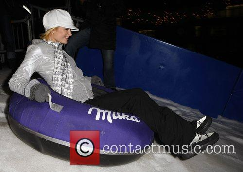 Enjoying a sleigh ride on an artificial ski...