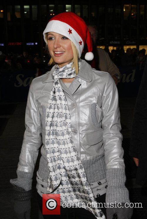 Paris Hilton with a Santa Clause hat at...