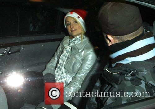 Paris Hilton with a Santa Clause hat leaving...