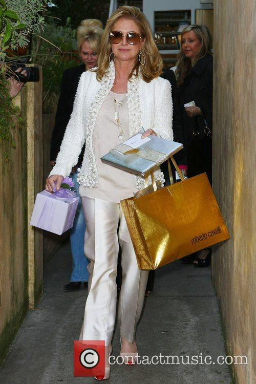 Kathy Hilton carrying gifts after celebrating her birthday...