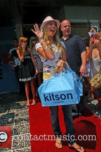 Ashley Tisdale Paris Hilton promotes her new clothing...