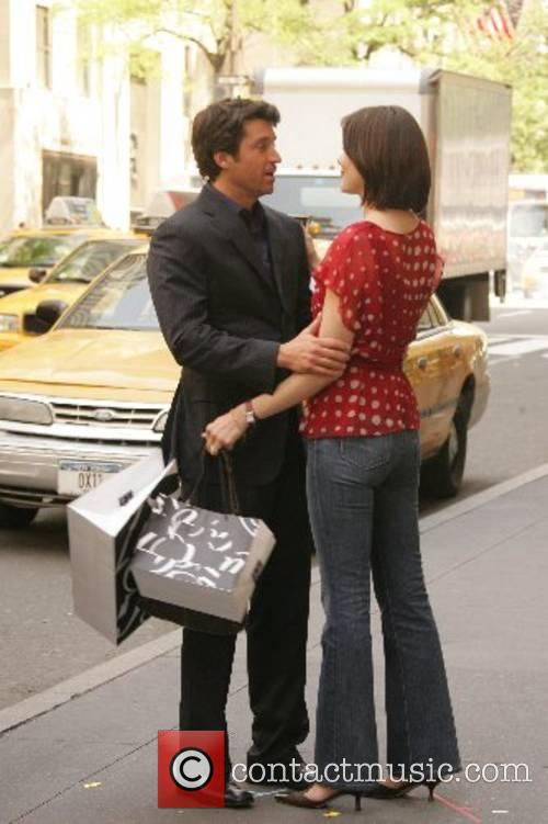 Patrick Dempsey and Michelle Monaghan embrace while filming...