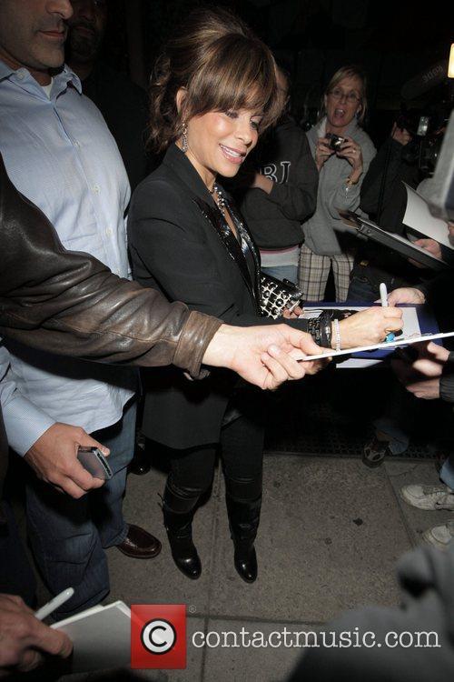 Paula Abdul  signs autographs for waiting fans...