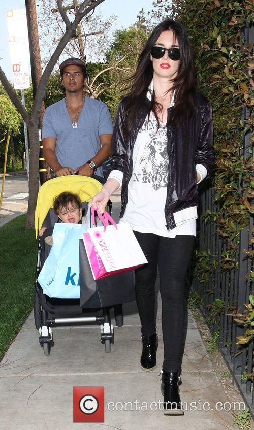 Paz Vega with her husband and son walking...