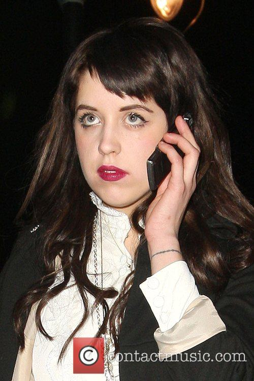 Peaches Geldof talks into her cellphone after playing...