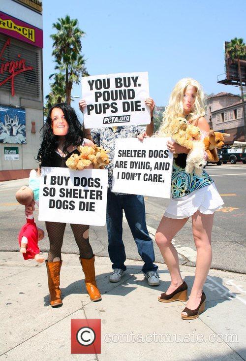 PETA members wearing masks of Britney Spears and...