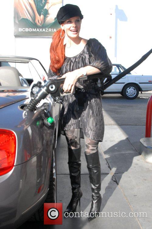 Phoebe Price pumps gas at a 76 gas...