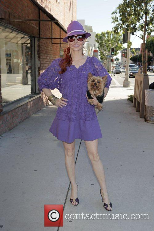 Shopping on Robertson Blvd with her yorkie terrier...
