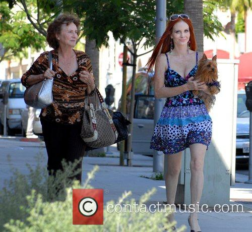 Phoebe Price walking with her mother and holding...