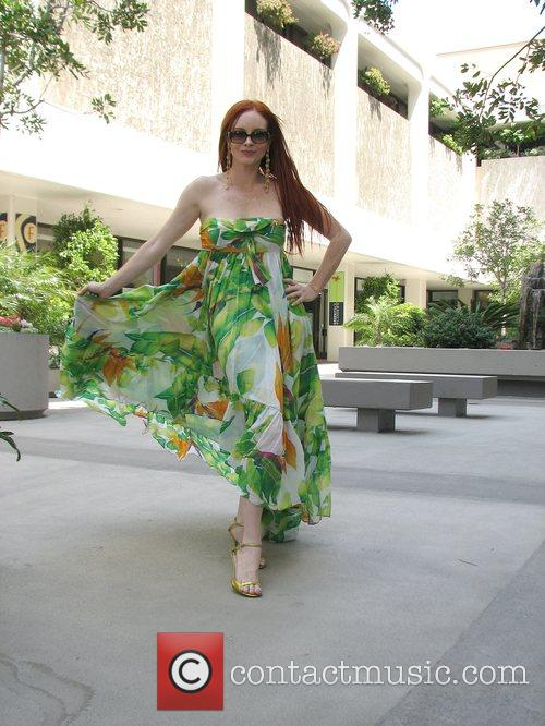 Wearing floral print summer dress, walking along Rodeo...