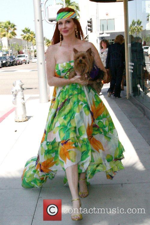Phoebe Price wearing floral print summer dress, walking...