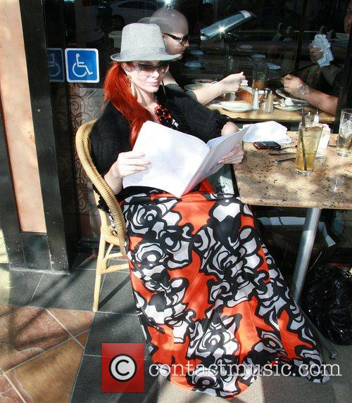 Phoebe Price eating at a restaurant in Beverly...