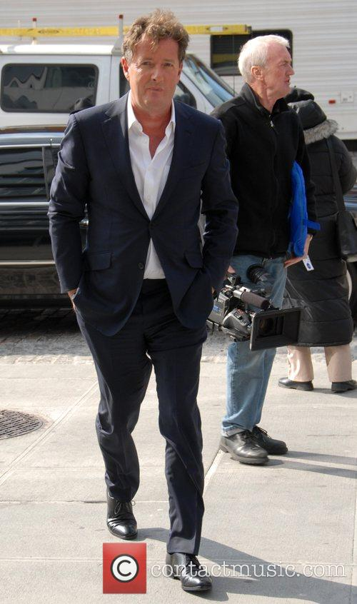 Piers Morgan walking with his hands in his...