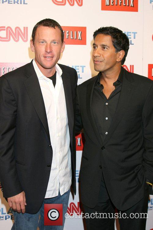 Lance Armstrong and Dr. Sanjay Gupta 8
