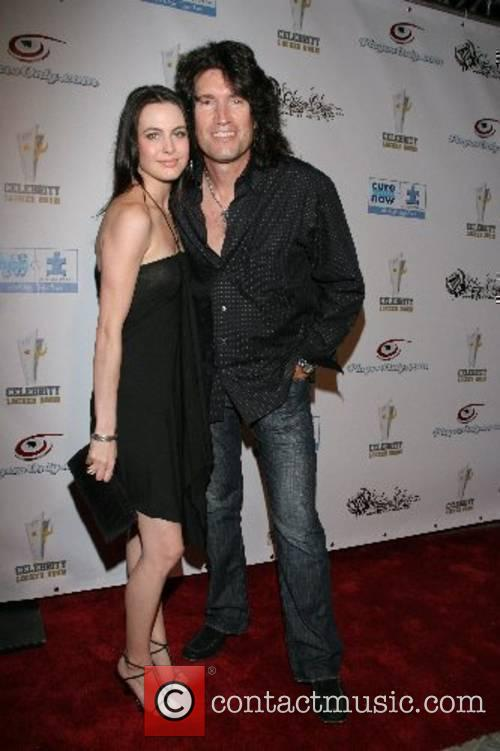 Amber Thayer and Tommy Thayer, guitarist for KISS...