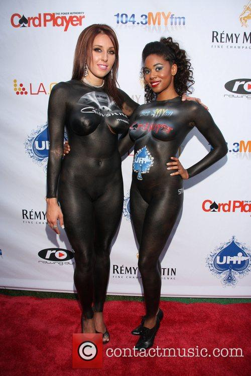 Brittany Moorehouse and Kim Grant modeling nude wearing...