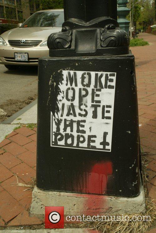 Anti-Pope posters at the Dupont Circle Washington DC,...
