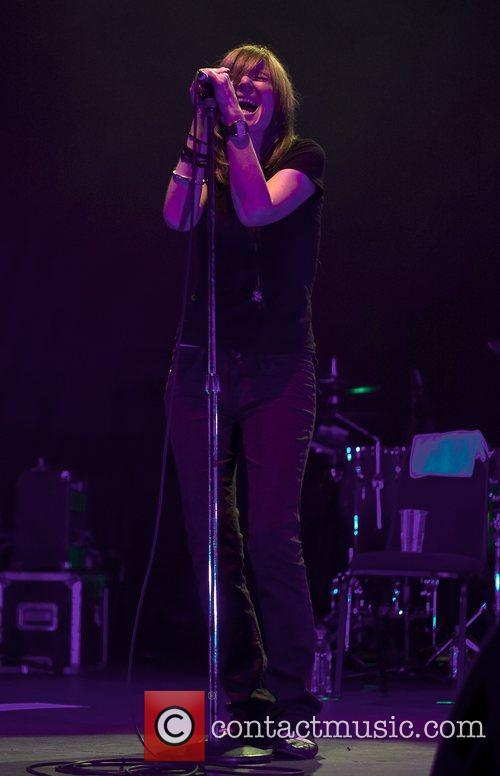 Beth Orton of Portishead under the lights performing...